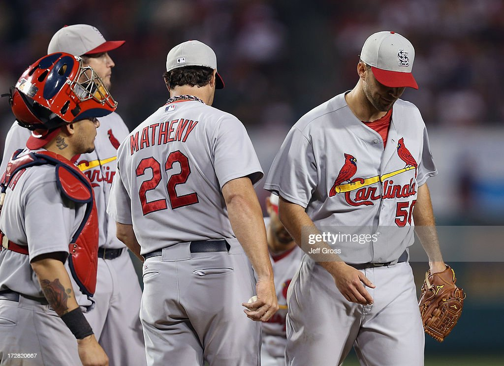 St. Louis Cardinals manager <a gi-track='captionPersonalityLinkClicked' href=/galleries/search?phrase=Mike+Matheny&family=editorial&specificpeople=171706 ng-click='$event.stopPropagation()'>Mike Matheny</a> #22 takes starting pitcher <a gi-track='captionPersonalityLinkClicked' href=/galleries/search?phrase=Adam+Wainwright&family=editorial&specificpeople=547879 ng-click='$event.stopPropagation()'>Adam Wainwright</a> (R) #50 out of the game in the ninth inning against the Los Angeles Angels of Anaheim at Angel Stadium of Anaheim on July 4, 2013 in Anaheim, California. The Angels defeated the Cardinals 6-5.