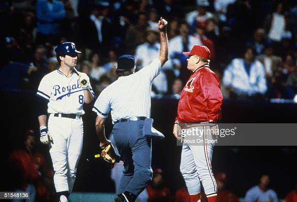 St Louis Cardinals' manager Whitey Herzog gets the heaveho from the home plate umpire as Kansas City Royals' batter Jim Sundberg looks on during the...