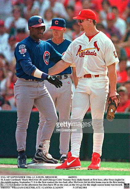 St Louis Cardinals'' Mark McGwire and Chicago Cubs'' Sammy Sosa shake hands at first base after Sosa singled in the eighth inning September 7 It is...