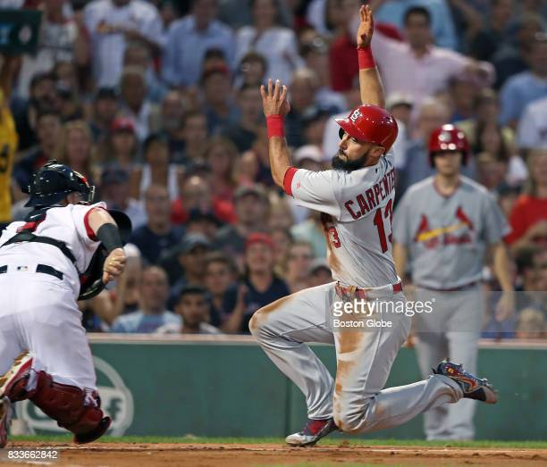 St Louis Cardinals' Matt Carpenter tries to avoid the tag of Red Sox catcher Christian Vazquez but is called out at the plate in the top of the...