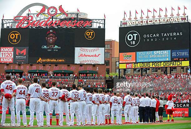 St Louis Cardinals observe a moment of silence for Oscar Taveras before a game against the Milwaukee Brewers at Busch Stadium on April 13 2015 in St...