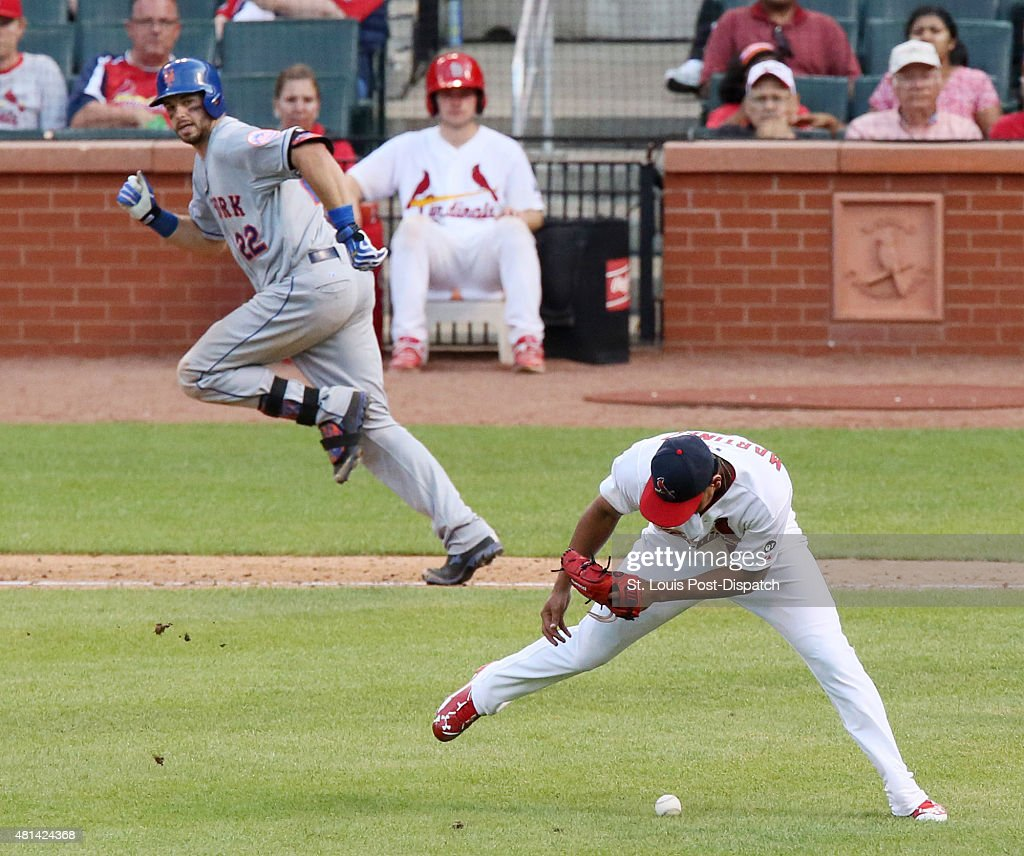 St Louis Cardinals pitcher Carlos Martinez right commits a fielding error as New York Mets' Kevin Plawecki left reaches on a sacrifice bunt to load...