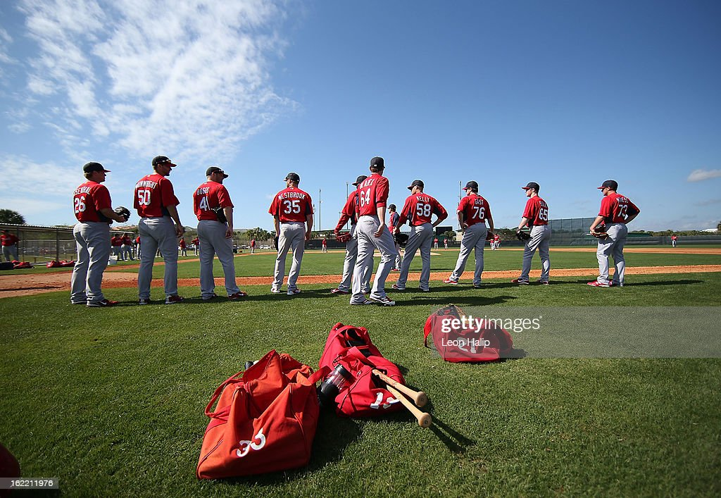 St. Louis Cardinals players line up and watch the action during spring training on February 20, 2013 in Jupiter, Florida.