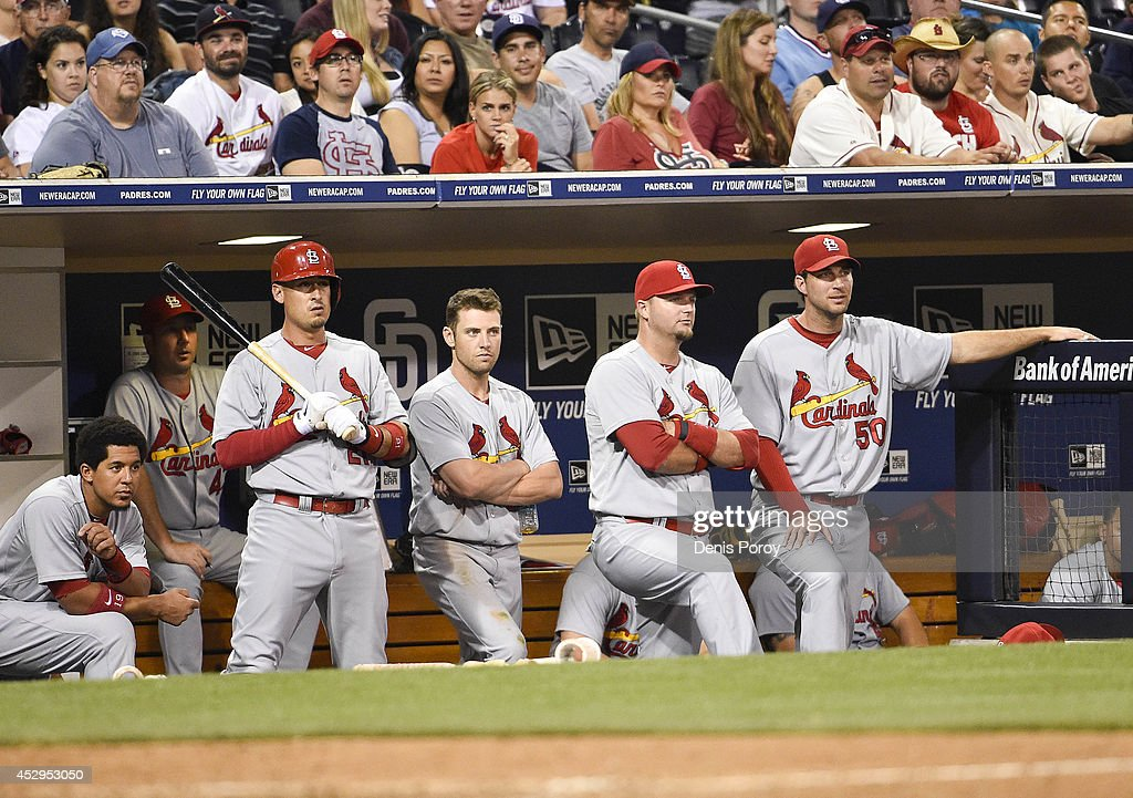St. Louis Cardinals players look out from the dugout during the eighth inning of a baseball game against the San Diego Padres at Petco Park July 30, 2014 in San Diego, California.