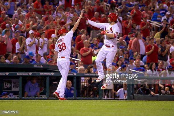 St Louis Cardinals right fielder Randal Grichuk gives St Louis Cardinals third base coach Mike Shildt a high five after hitting a home run in the...