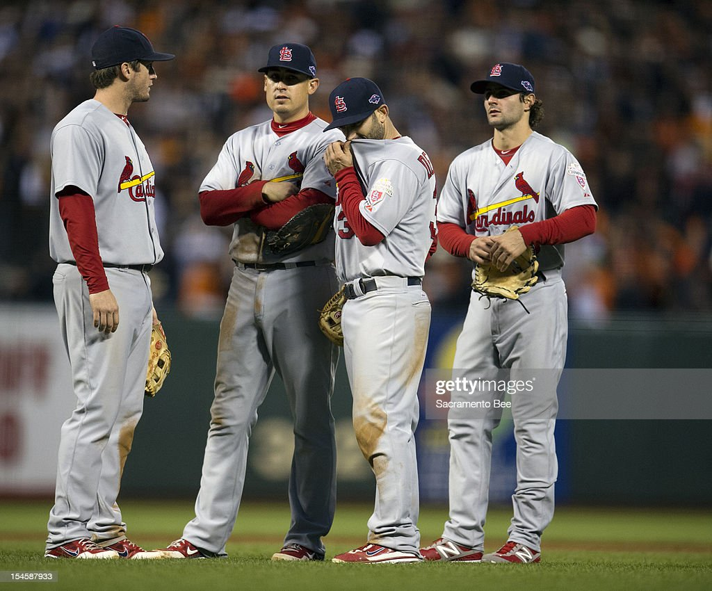 St. Louis Cardinals second baseman Daniel Descalso (33), hand to face, and other members of the Cardinals wait during a pitching change in the third inning during Game 7 of Game 7 of the National League Championship Series between the St. Louis Cardinals and the San Francisco Giants at AT&T Park on Monday, October 22, 2012, in San Francisco, California.