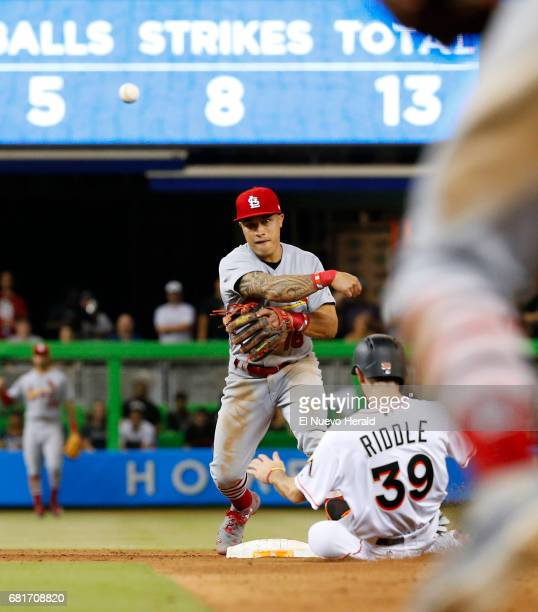 St Louis Cardinals second baseman Kolten Wong throws to first base to complete a double play in the ninth inning as Miami Marlins pinch runner JT...