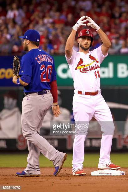 St Louis Cardinals shortstop Paul DeJong hits a double against the Chicago Cubs during a MLB baseball game between the St Louis Cardinals and the...