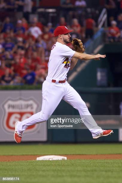 St Louis Cardinals shortstop Paul DeJong throws to first for the out against the Chicago Cubs during a MLB baseball game between the St Louis...