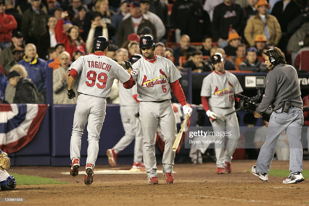 St. Louis Cardinals <a gi-track='captionPersonalityLinkClicked' href=/galleries/search?phrase=So+Taguchi&family=editorial&specificpeople=183399 ng-click='$event.stopPropagation()'>So Taguchi</a> being welcomed at home plate by <a gi-track='captionPersonalityLinkClicked' href=/galleries/search?phrase=Albert+Pujols&family=editorial&specificpeople=171151 ng-click='$event.stopPropagation()'>Albert Pujols</a> after hitting go ahead home run against the New York Mets during game 2 of the MLB National League Championship Series played at Shea Stadium in Flushing, N.Y. Cardinals defeated the Mets 9 - 6 on October 13, 2006.