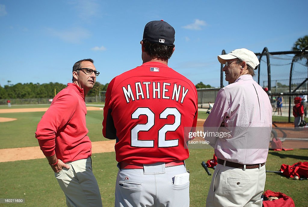 St. Louis Cardinals Sr. Vice President and General Manager John Mozeliak, Manager Mike Matheny and Chairman and Chief Executive Officer William O. DeWitt watch the action during spring training on February 20, 2013 in Jupiter, Florida.