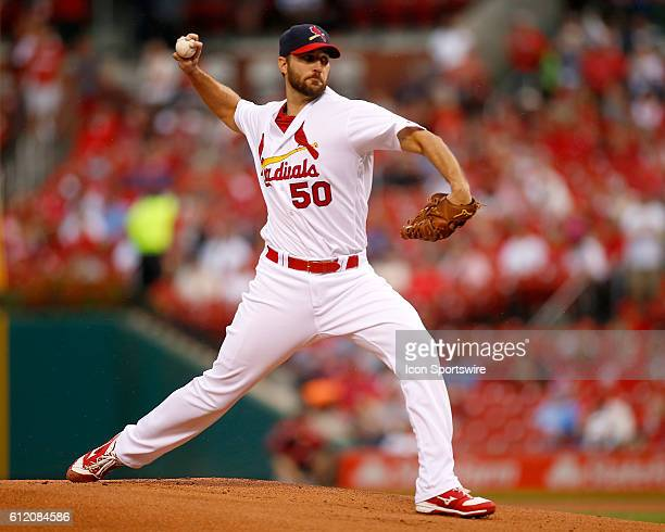 St Louis Cardinals starting pitcher Adam Wainwright pitches during the first inning of a baseball game against the Pittsburgh Pirates at Busch...