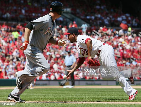 St Louis Cardinals starting pitcher Carlos Martinez flips the ball to home plate after fielding a sacrifice bunt by Miami Marlins' Chris Narveson...