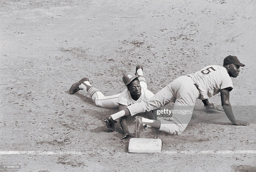 <a gi-track='captionPersonalityLinkClicked' href=/galleries/search?phrase=Lou+Brock&family=editorial&specificpeople=207012 ng-click='$event.stopPropagation()'>Lou Brock</a>'s helmet falls off as Cards' speedster hustles back to 1st on pick off try in 6th inning of 3rd game of World Series. Boston 1st baseman George Scott watches ball which was thrown wildly by pitcher Lee Stange. Brock went to 3rd, then scored on Roger Maris' single. Cards won, 5-2, to take series lead, 2 games to 1.