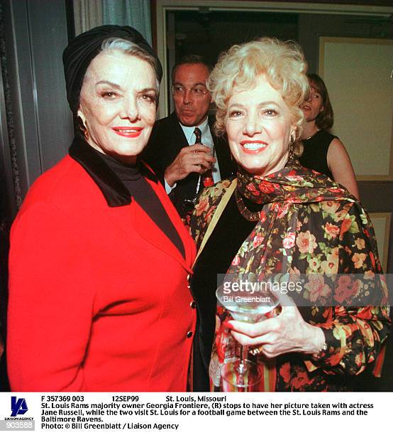 St Louis Missouri St Louis Rams majority owner Georgia Frontiere stops to have her picture taken with actress Jane Russell while the two visit St...