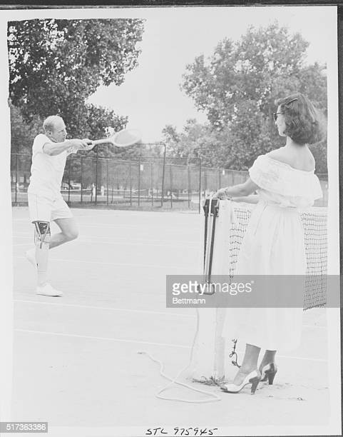 Net Results Mrs Mary Frances Veeck wife of Bill Veeck the new owner of the St Louis Browns watches as he slams one across the net Bill who lost his...