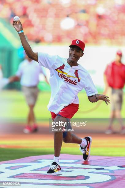 St Louis native Patrick McCaw of the Golden State Warriors throws out a ceremonial first pitch prior to a game between the St Louis Cardinals and the...