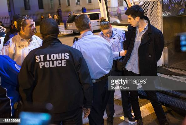 St Louis Police arrest photojournalist Philip Montgomery at a protest staged by Ferguson activists on March 14 2015 in St Louis Missouri St Louis and...