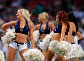 St Louis Rams cheerleaders perform during a timeout in the preseason game against the Green Bay Packers at Edward Jones Dome on August 16 2014 in St...
