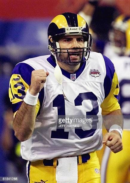 St Louis Rams quarterback Kurt Warner celebrates after throwing a touchdown pass to wide receiver Torry Holt in the second half of Super Bowl XXXIV...