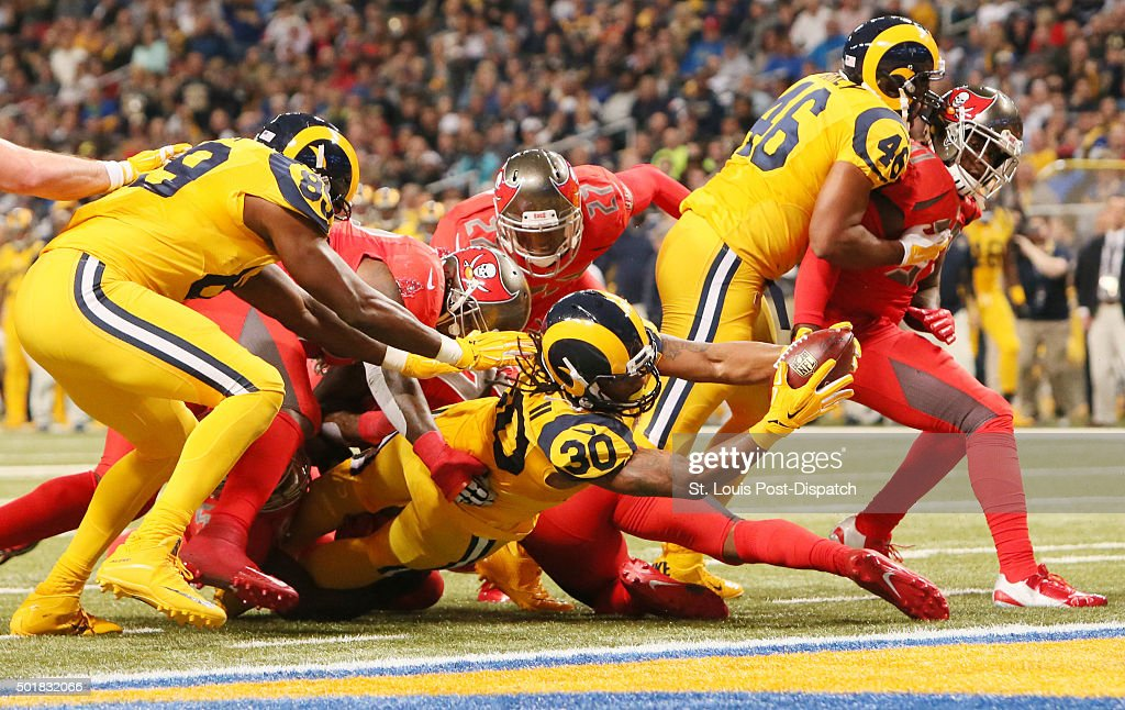 St. Louis Rams running back Todd Gurley scores on a 3-yard touchdown run in the second quarter against the Tampa Bay Buccaneers on Thursday, Dec. 17, 2015, at the Edward Jones Dome in St. Louis. The Rams won, 31-23.