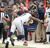 St Louis Rams wide receiver Brian Quick is unable to catch a pass while being defended by Seattle Seahawks cornerback Tharold Simon but Simon was...