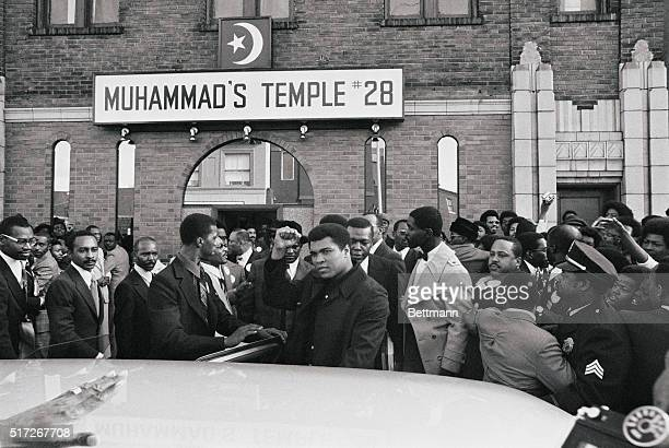 World heavyweight boxing champ Muhammad Ali gives the black power salute as he leaves the Muhammad Muslim Temple during his visit to St Louis 12/5...