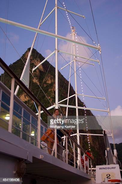 St Lucia Island View Of Island Cruise Ship Wind Surf Passengers On Deck Piton Peak In BACKGROUNDModel Releases 005 Model Releases 006 Model Releases...