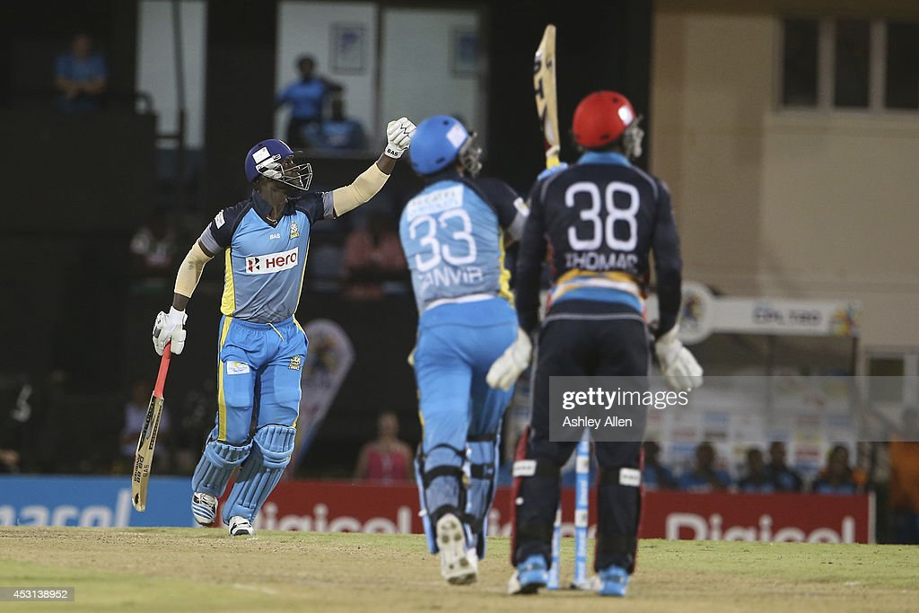St Lucia Zouks captain <a gi-track='captionPersonalityLinkClicked' href=/galleries/search?phrase=Darren+Sammy&family=editorial&specificpeople=2920912 ng-click='$event.stopPropagation()'>Darren Sammy</a> (L) celebrates as <a gi-track='captionPersonalityLinkClicked' href=/galleries/search?phrase=Sohail+Tanvir&family=editorial&specificpeople=4499888 ng-click='$event.stopPropagation()'>Sohail Tanvir</a> (C) and Devon Thomas (R) look on during a match between St. Lucia Zouks and Antigua Hawksbills as part of week 4 of the Limacol Caribbean Premier League 2014 at Beausejour Stadium on August 03, 2014 in Castries, St. Lucia.