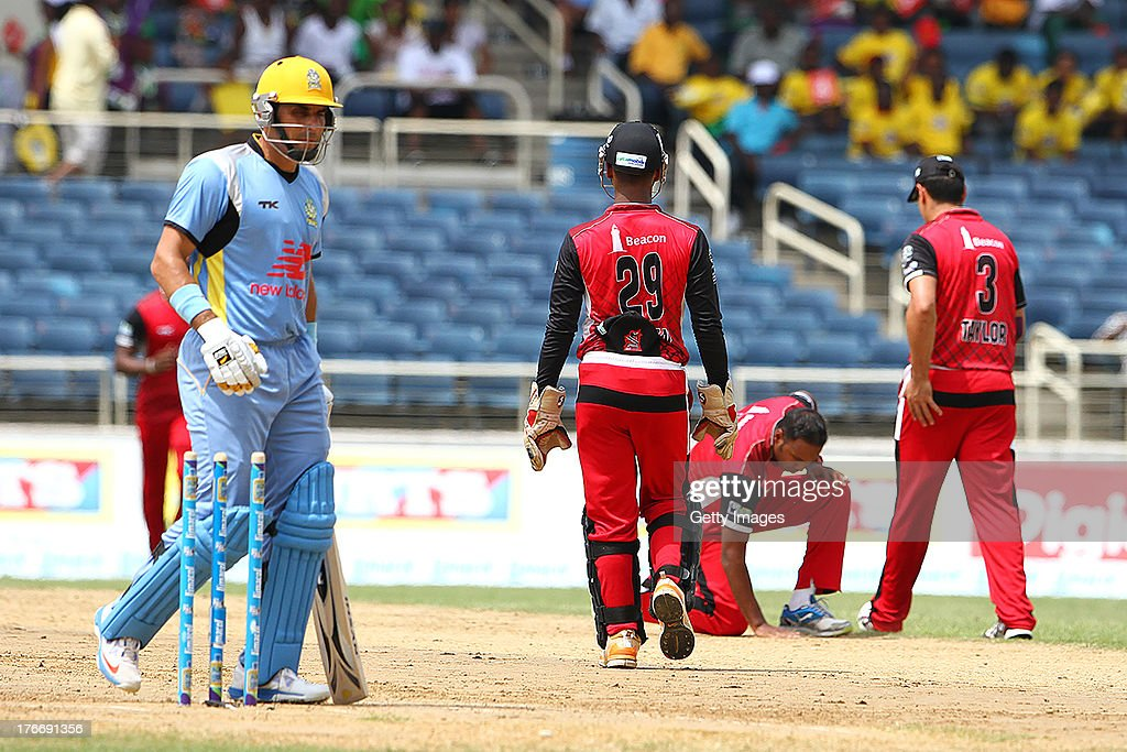 St Lucia Zouks Misbah-Ul-Haq is dismissed by Samuel Badree during the Eighteenth Match of the Cricket Caribbean Premier League between St. Lucia Zouks v Trinidad and Tobago Red Steel at Sabina Park on August 17, 2013 in Kingston, Jamaica.