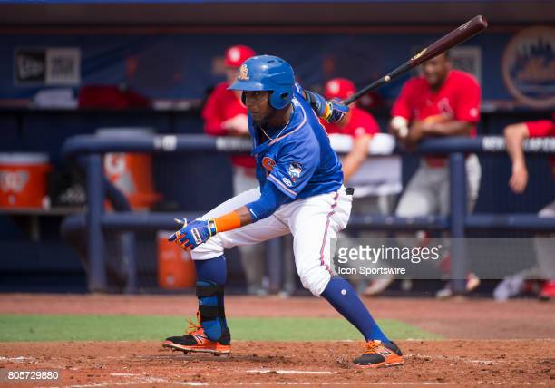 St Lucie Mets Outfielder John Mora bats during the first game of a double header MiLB minor league baseball game between the Palm Beach Cardinals and...
