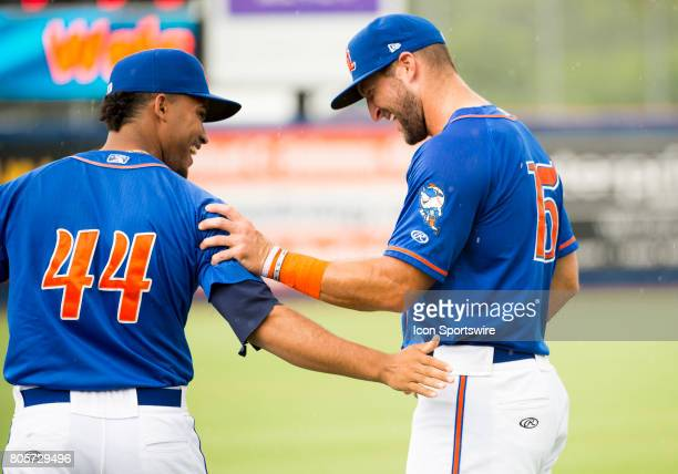 St Lucie Mets Outfielder Tim Tebow laughs with St Lucie Mets Pitcher Merandy Gonzalez as they warm up on the field before the start of the first game...