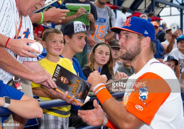 St Lucie Mets Outfielder Tim Tebow signs autographs for fans in the stands before the start of the second game of a double header MiLB minor league...