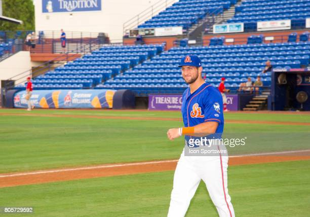 St Lucie Mets Outfielder Tim Tebow smiles as he walks onto the field before the start of the first game of a double header MiLB minor league baseball...