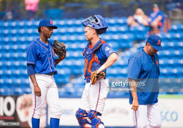St Lucie Mets Pitcher Justin Dunn speaks with St Lucie Mets Catcher Patrick Mazeika on the mound during the first game of a double header MiLB minor...