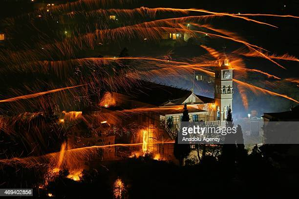 St Mark's and Panagia Erithiani church congregations perform 'Rocket War' by firing thousands of homemade rockets across the sky during Greek...