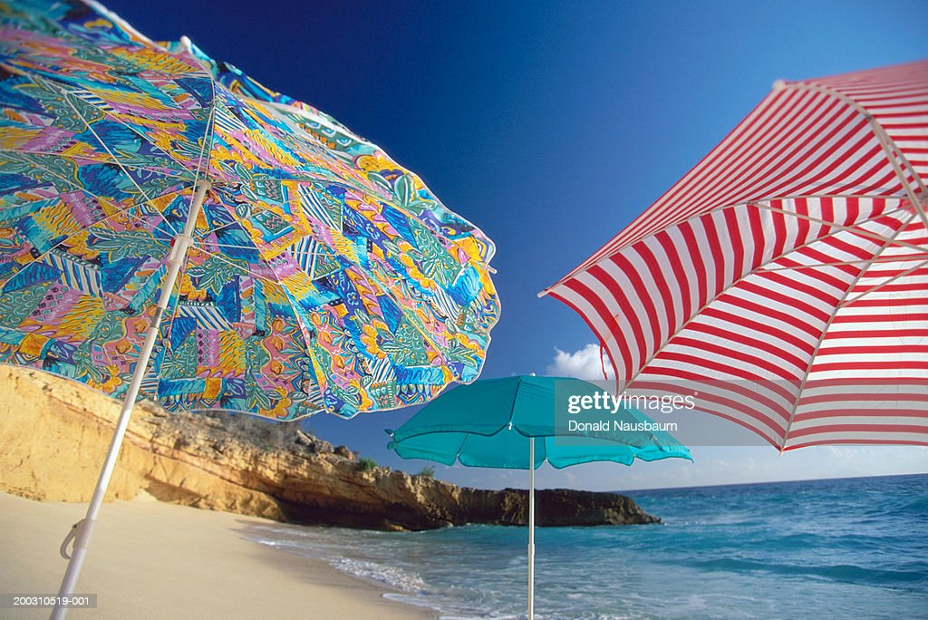 St Martin, colorful umbrellas on Cupecoy Beach