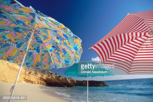 St Martin, colorful umbrellas on Cupecoy Beach
