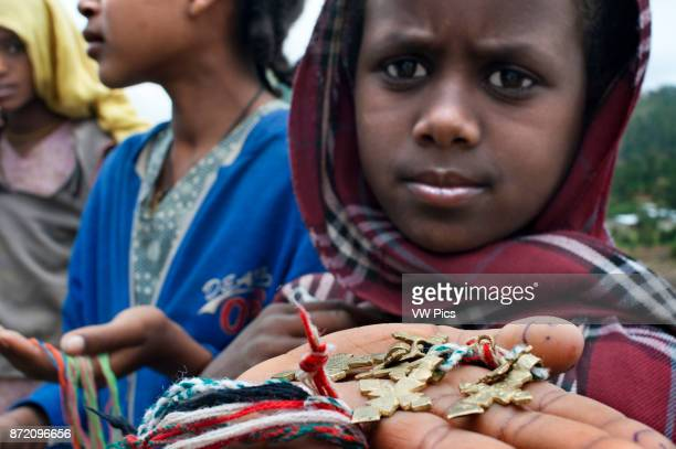 St Mary of Zion church Aksum Ethiopia Children sell souvenirs at the gates of St Mary of Zion Church in Axum The most sacred shrine in Ethiopia is...