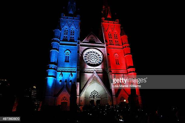 St Mary's Cathedral is lit in French colours following a mass in honour of the victims and those affected by the recent Paris attacks on November 16...