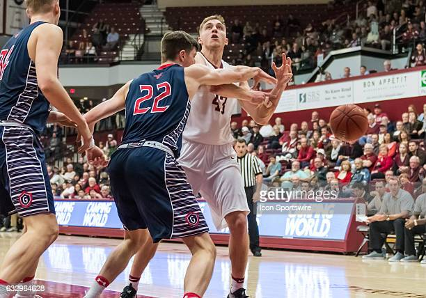St Mary's Gaels forward Dane Pineau knocks the ball loose as Santa Clara Broncos forward Nate Kratch goes up for a shot during the regular season...