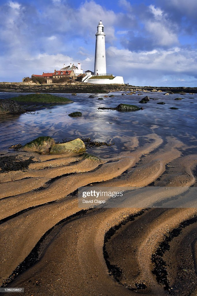 St Mary's Lighthouse with sand patterns, Whitley Bay, Newcastle, UK : Stock Photo