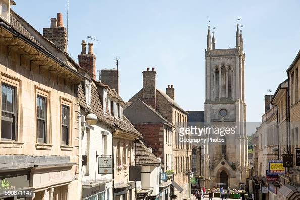 St Michael's Church tower and buildings in Ironmonger Street Stamford Lincolnshire England UK