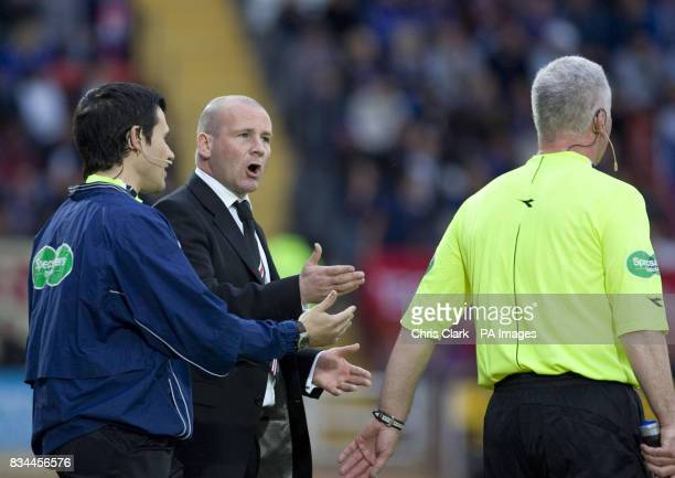 St Mirren's manager Gus McPherson argues with linesman and fourth official during the Clydesdale Bank Premier League match at St Mirren Park Paisley