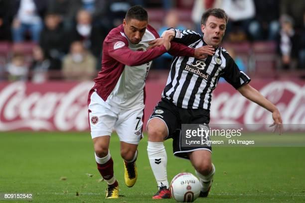 St Mirren's Paul McGowan and Heart of Midlothian's Suso Santana battle for the ball