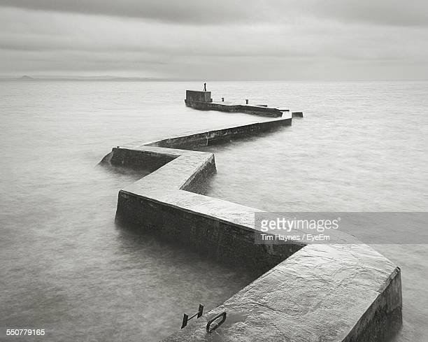St Monans Zigzag Shaped Breakwater Against Cloudy Sky