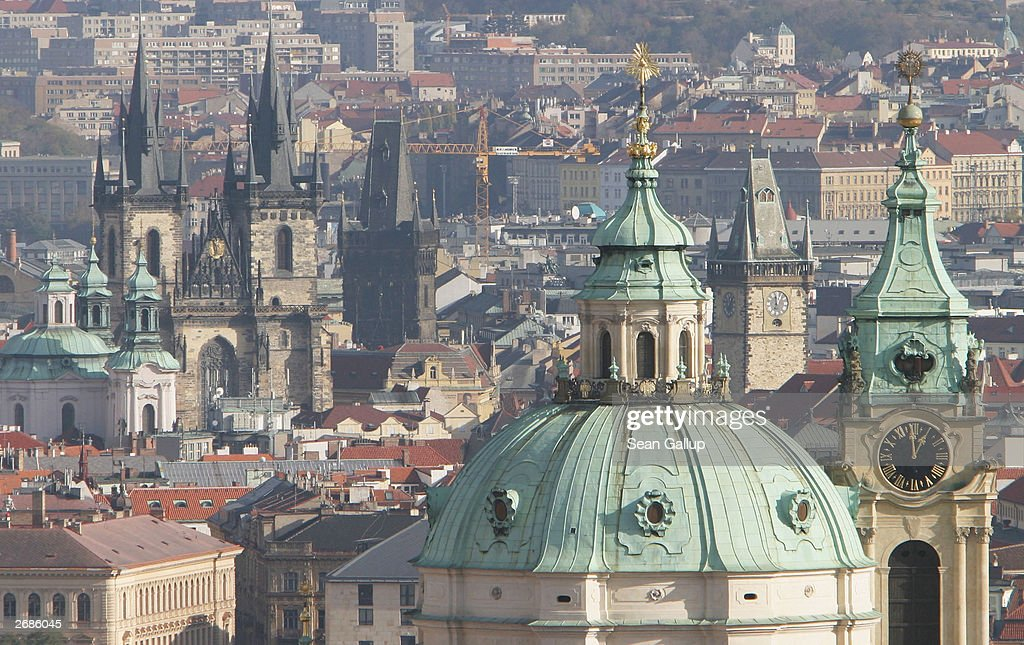St. Nicholas Church (Right foreground) and Tyn Church (Left with two towers) rise up from the skyline October 31, 2003 in Prague, Czech Republic. Prague emerged largely unscathed from World War II and has become one of Europe's main tourist destinations.