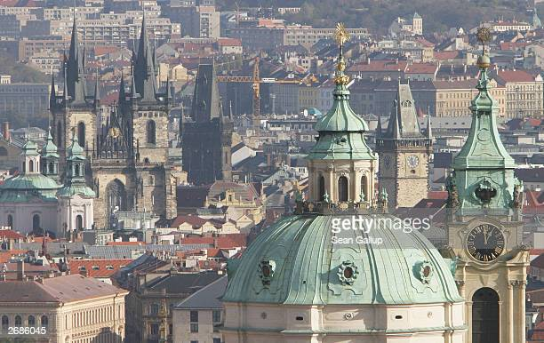 St Nicholas Church and Tyn Church rise up from the skyline October 31 2003 in Prague Czech Republic Prague emerged largely unscathed from World War...