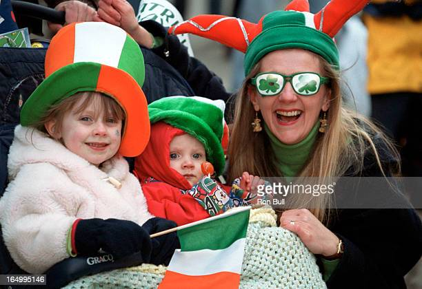 St Patricks Day Parade 03/18/01 Three people together Mother is Caitriona WalshCussen with glassesof clover leaf wither children Riley 5 and Taryn 1...