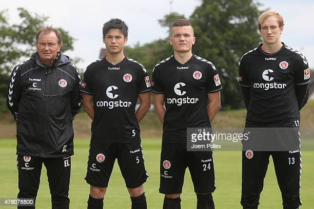 St Pauli Football Club's head coach Ewald Lienen poses with the new players Ryo Miyaichi Nico Empen and Svend Brodersen on June 22 2015 in Hamburg...